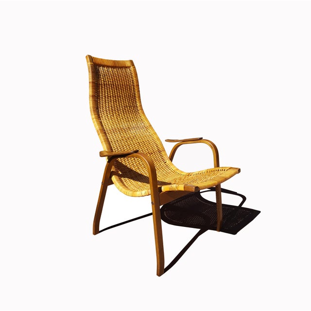 DESCRIPTION Yngve Ekström (1913-1988) Kurva Lounge Chair Beech, teak wood and cane made in Sweden Circa 1950 H 97 × L 66 ×...