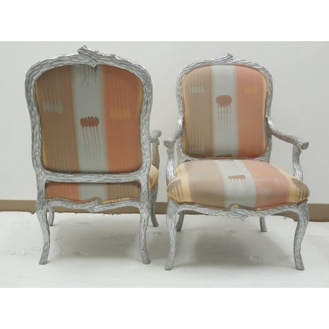 From a prominent designer's 1980s Palm Springs estate, a set of six faux bois twig dining chairs done in silver leaf....