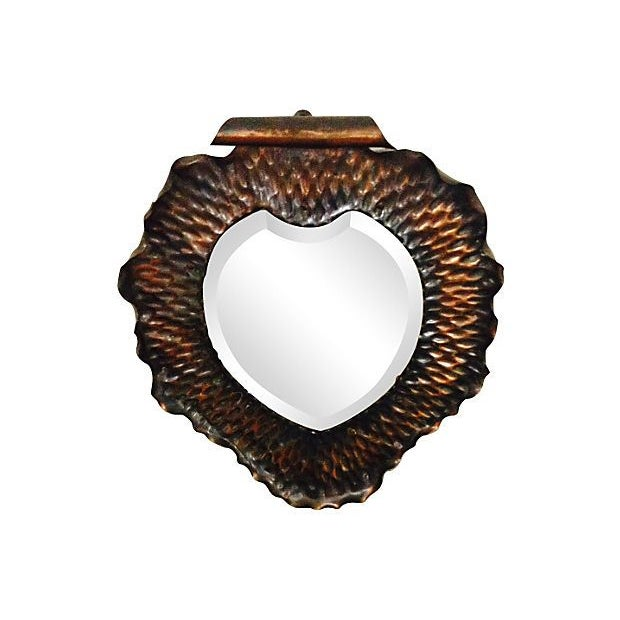 "A sweet vintage heart shaped copper mirror with a beveled edge. The mirror is nearly 1 foot wide and 14"" tall - perfect to..."