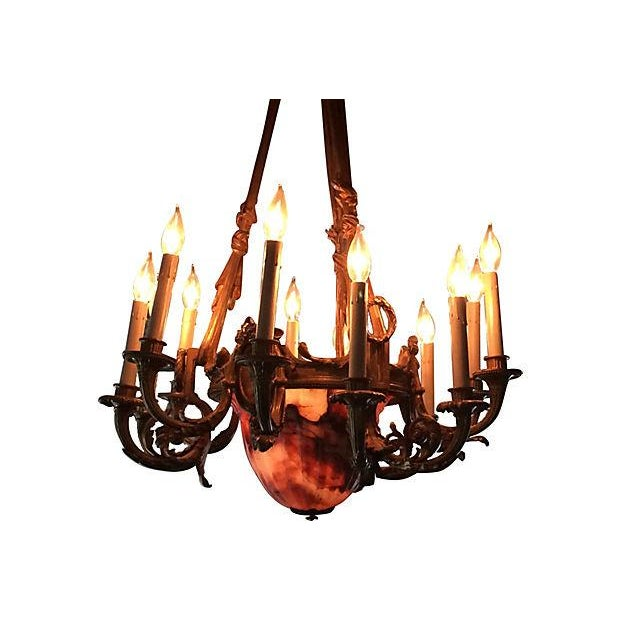 Large 1940s French alabaster and bronze chandelier with thirteen lights. Ornate bronze framework features hand-painted...