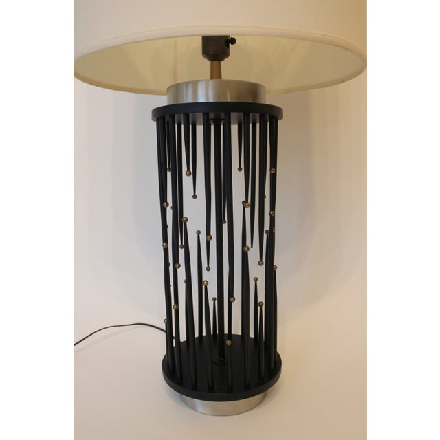 Iconic and hard to find, these iconic lamps are made of metal and wood: The bases and accents are brushed chrome and the...
