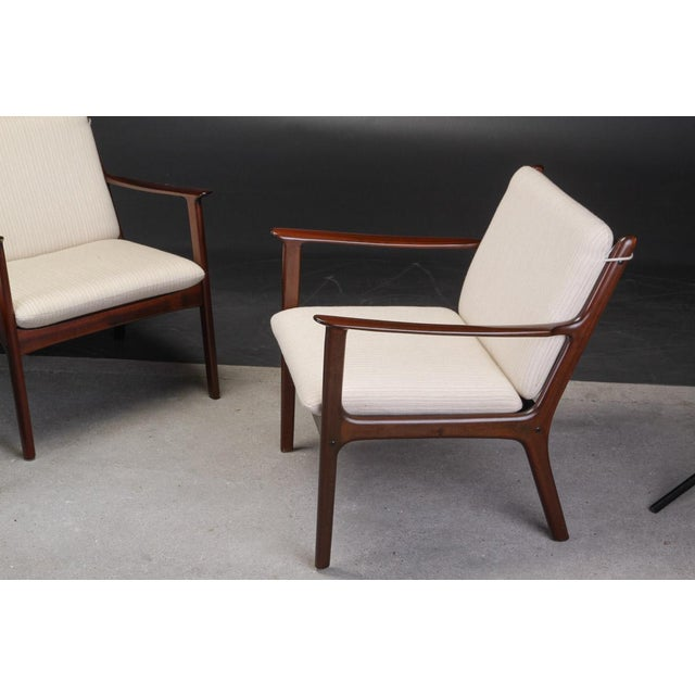 Set of two Danish Ole Wanscher PJ112 mahogany lounge chairs produced by P. Jeppesens Møbelfabrik, Frames and upholstery of...