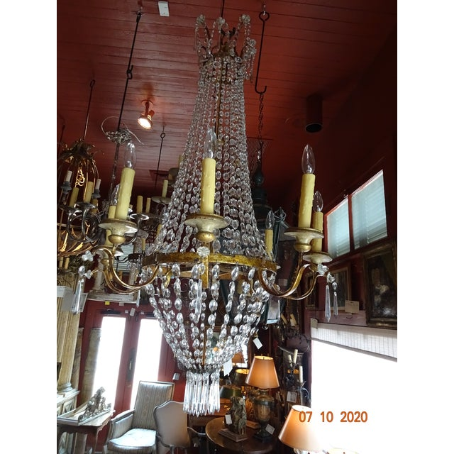 Beautiful early 19th Century crystal chandelier from Lucca, Italy. The iron is gilded. 8 iron arms. US wired. Painted wood...
