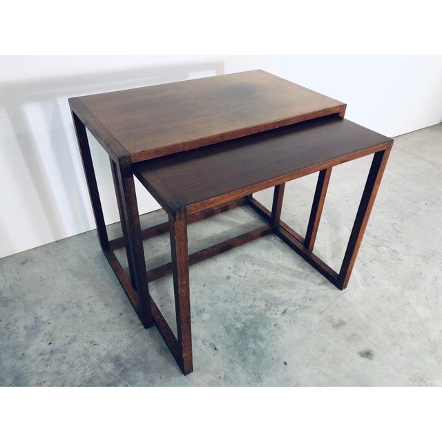 Two walnut nesting tables in original condition. Made in the 1970s.