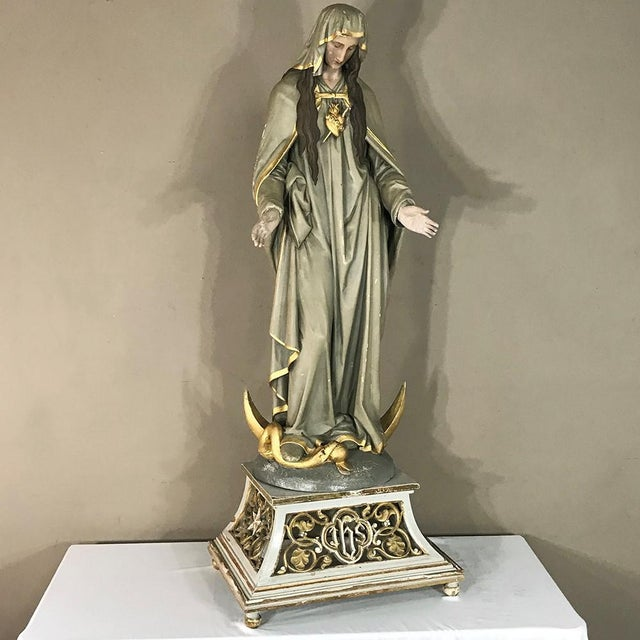 19th Century Hand-Painted Polychrome Madonna is a wonderfully sculpted depiction of the Virgin Mary that was artistically...