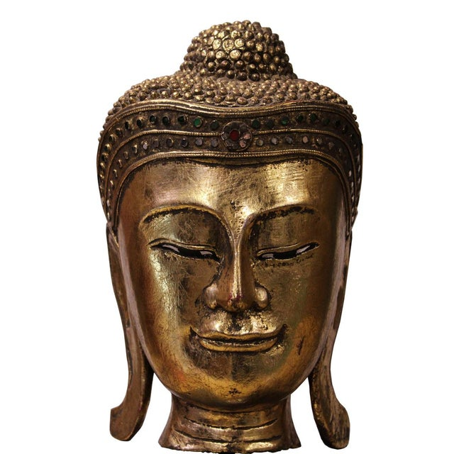 Master handcrafted Buddha head on stand, this statue is carved with solid wood painted with gold color, decorate with...