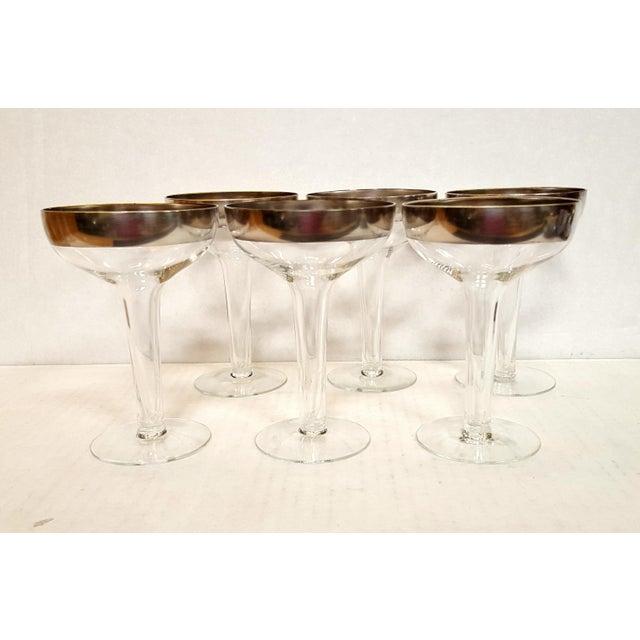 Dorothy Thorpe Hollow Stem Champagne Glasses Origin: USA Quantity: 6 champagne glasses Condition/Info: Very Good Plus....