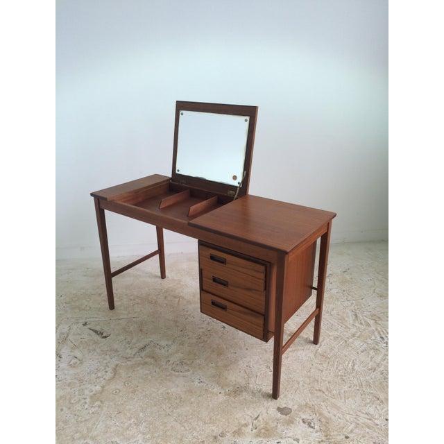"""Exquisite Danish make-up desk. Beautiful teak veneer. Flip top opens to reveal mirror. Interior storage of desk is 21""""w x..."""