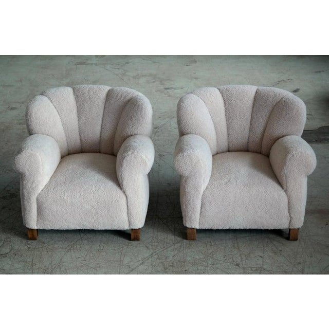 Pair of sublime large scale pair of model 1518 lounge club chairs made by Fritz Hansen in the late 1930s or early 1940s....