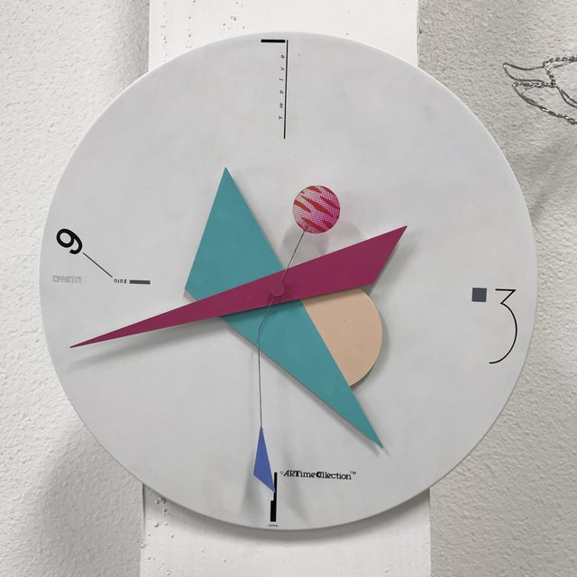 Funky modern wall clock by Canetti for their Arttime Collection and made in Japan. It functions well and keeps good time.