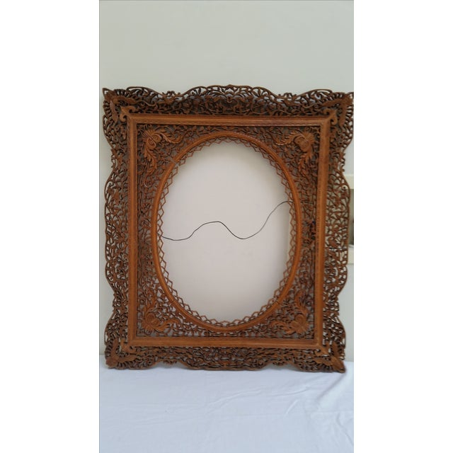 Early 19th century ornately carved Anglo-Indian Frame. This would be great for a mirror frame or an oval painting.