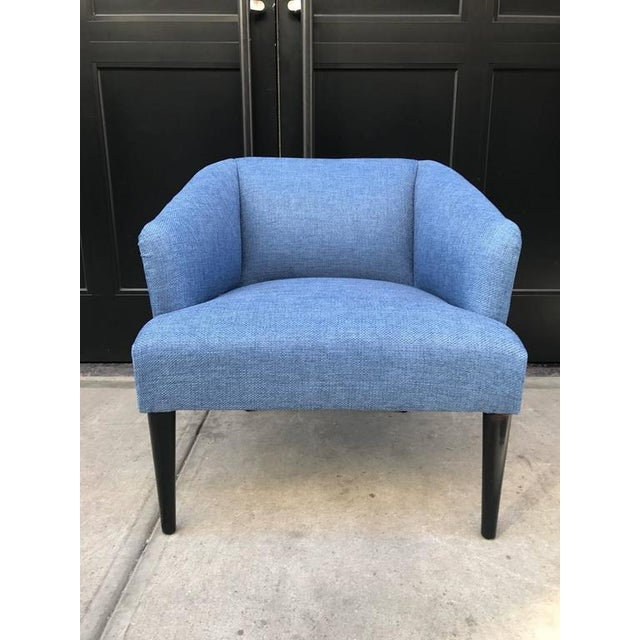 Pair of Mid-Century Modern lounge chairs. Newly upholstered. Chairs have black lacquered wood legs.