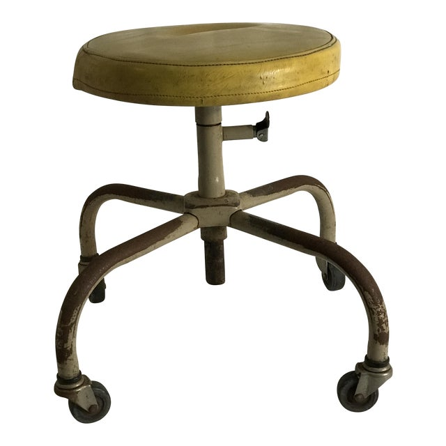 Vintage Industrial Casters Low Stool with Yellow Vinyl - Image 1 of 10