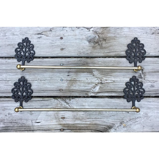 "Two matching antique hand towel bars/ towel racks/ towel hangers. All metal components. Each one is 19"" at widest. towel..."
