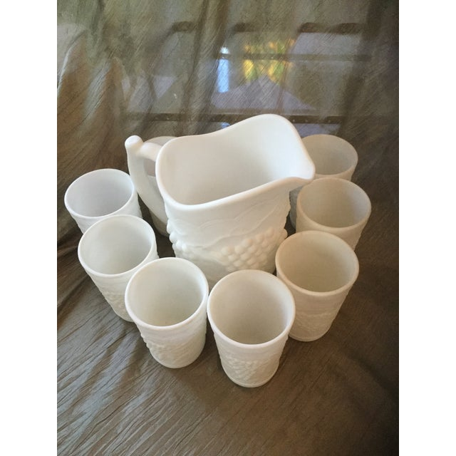 Vintage rare satin milk glass beverage set. Stunning classical grapevine patten is highly desirable in this hi relief...