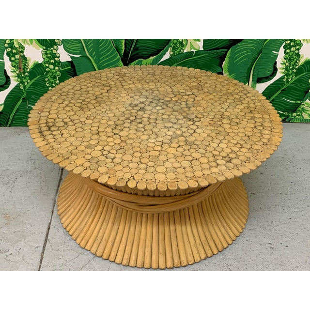 Vintage McGuire sheaf of wheat coffee or cocktail table features iconic bound rattan design. Good vintage condition with...
