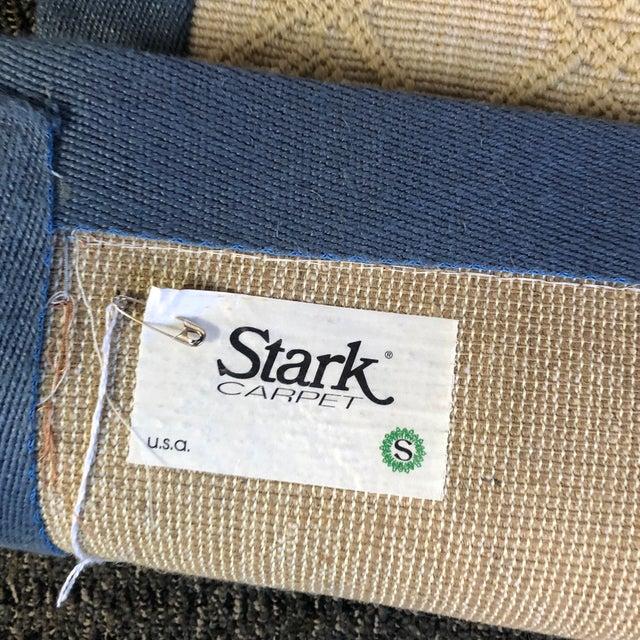 beautiful wool sisal carpet with blue linen border custom made.The carpet is a soft tan trellis tone on tone pattern
