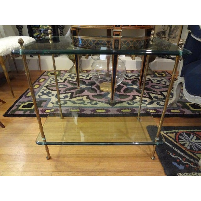 Gorgeous Italian Louis XVI or Directoire style bronze or brass faux bamboo two tiered table with thick beveled glass tops,...