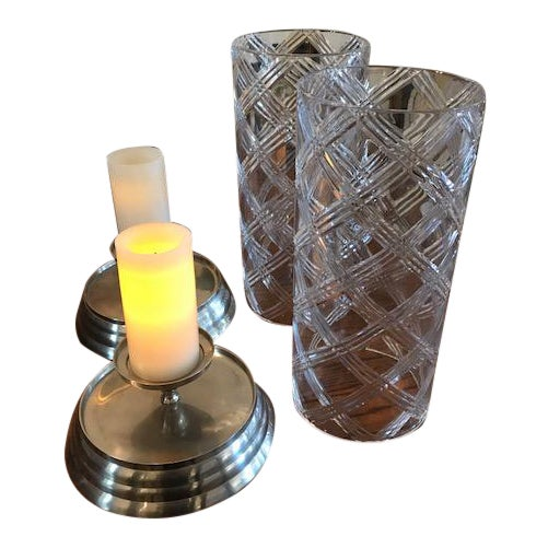 Beautiful etched crystal hurricanes globes, with candles (not included.) Perfect for your holiday table. Sold as a pair.