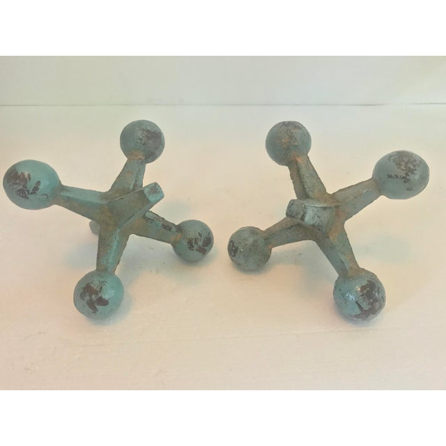 For a touch of whimsy in your decor, try these large scale jacks! Made from solid heavy cast iron, and painted turquoise,...