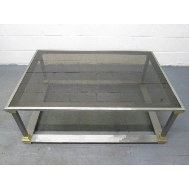Brushed Steel and Brass Coffee Table. Table has a smoked glass top.