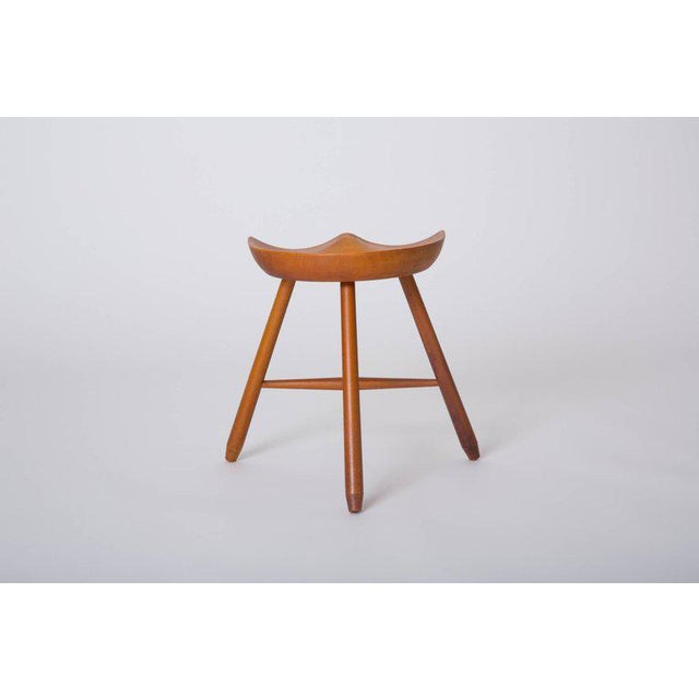 A modernist take on the three-legged milking stool of which Arne Hovmand-Olsen's is the most famous, this piece features...