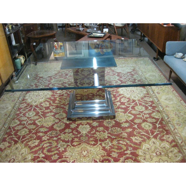 This listing consist of a very nice mid century modern stainless steel dining room table by Brueton. It is in excellent...