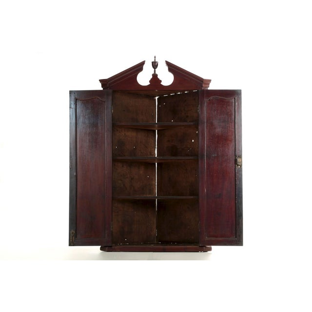 A most attractive hanging corner cupboard, it displays with a most attractive angularity emphasized by the cove-molded...