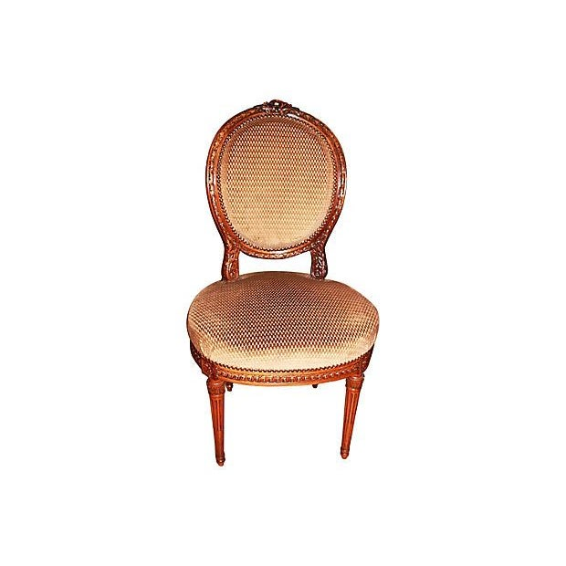 Stunningly carved three-piece 19th-century French salon set, that includes a settee and two accent chairs. Subtly detailed...