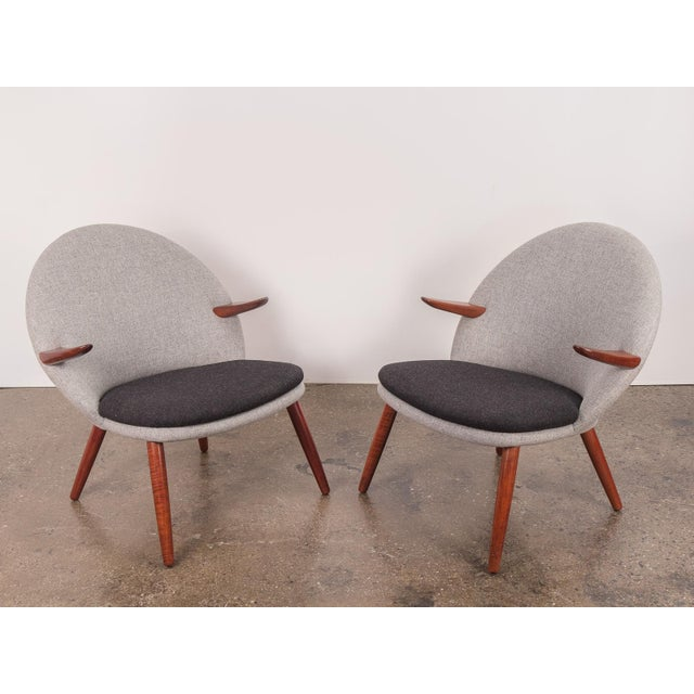 Unusual pair of Easy Chairs by Kurt Olsen for Glostrup Mobelfabrik. These chairs have been fully restored. The form boasts...