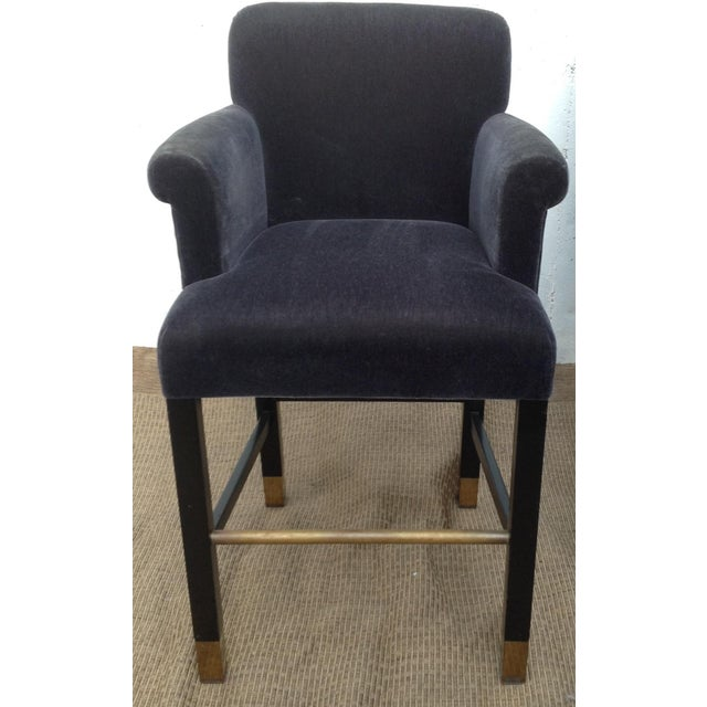 Wonderful plush slate-blue mohair barstools by iconic Donghia. Legs are ebonized with brass foot rests. Set of four....