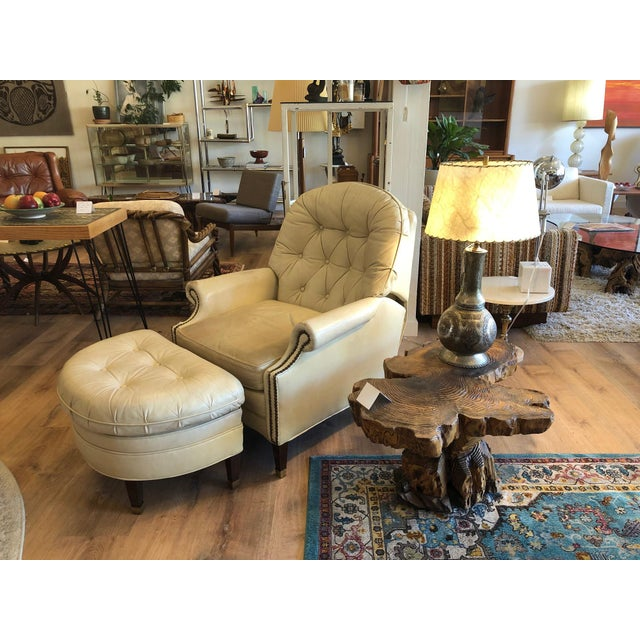 Tufted off-white leather lounge chair / recliner with ottoman. Distressing on arm rests and subtle discoloration and...