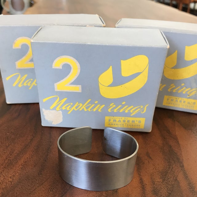 Set of 5 stainless steel Swedish napkin rings by Cultura. The original boxes are also included. They are in excellent...