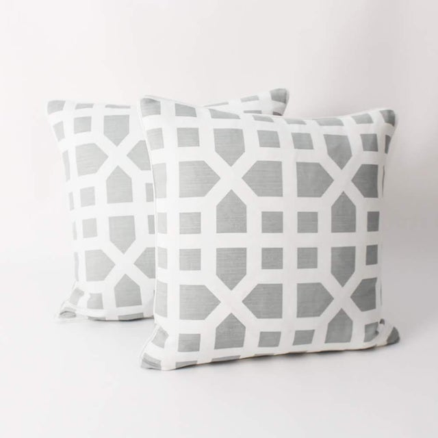 Pair of custom light blue and ivory Lee Jofa avignon trellis pattern pillows. Patterns on fronts and backs, solid...