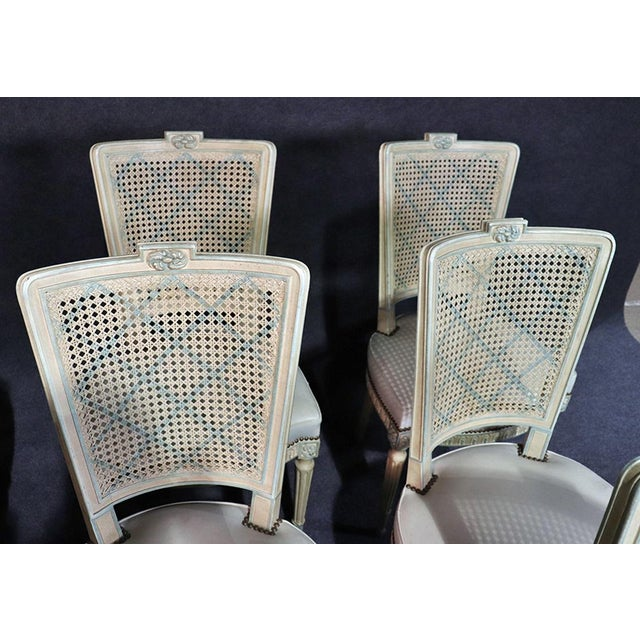 These gorgeous Louis XVI style chairs feature the iconic trademarks of Maison Jansen. With their undamaged painted cane...