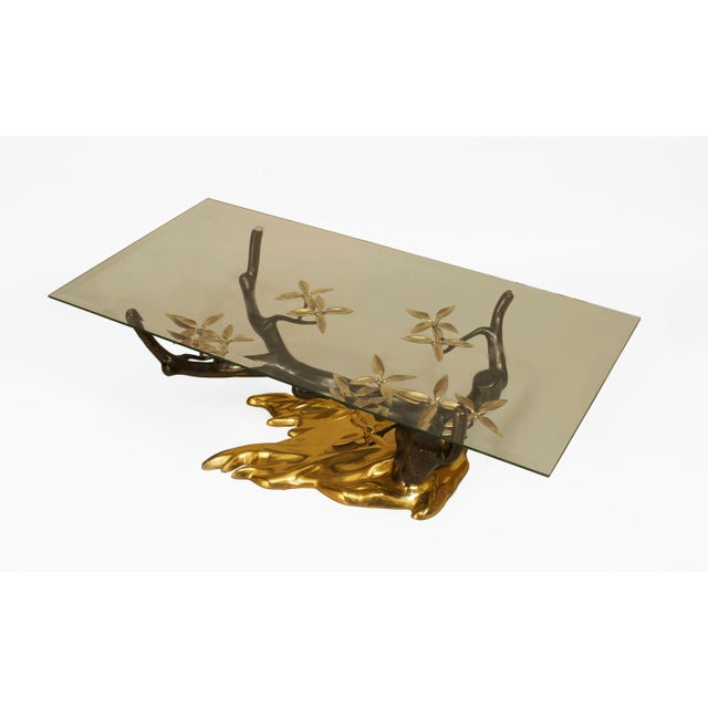 "Belgian post-war design (1970s) coffee table with a bronze ""TREE"" form base having brass patinated leaves under a..."
