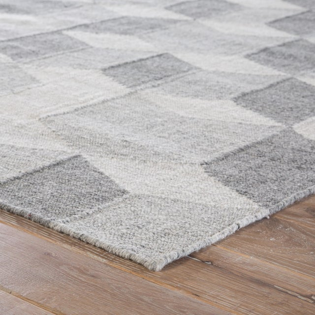 This dhurrie-style area rug infuses both indoor and outdoor spaces with a modern touch of geometric patterning. Shadow...
