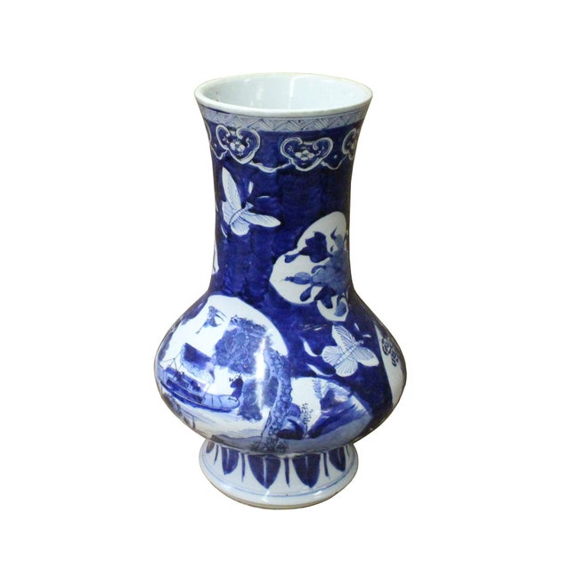This is a Chinese decorative porcelain vase in Blue and White color finish. The theme is oriental white flower tree...