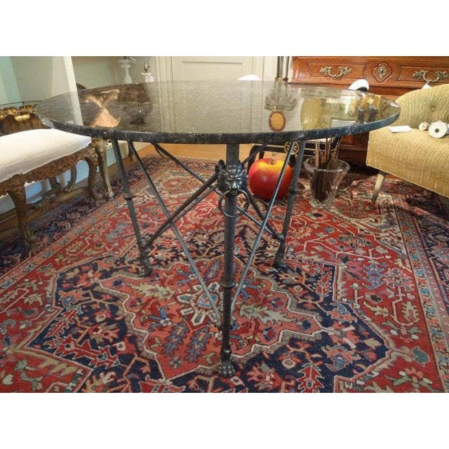 Stunning Italian Giacometti inspired Neoclassical style steel and bronze center table with marble top. This fabulous...