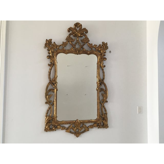 Beautiful 1940s Gold Mirror with exquisite details. Perfect accent for any room. This mirror adds timeless sophistication...