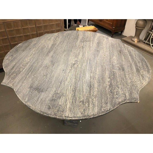 This grey washed pedestal table is perfect addition to any rustic home design. Made in the 2010s.