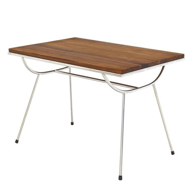 Established Lines, mid century modern decor, Sputnik base lamp table looking very light to the eye, standing on tall...