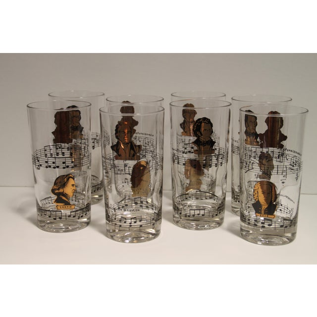 Lovely set of eight vintage glasses featuring various classical composers. Overall good condition with some loss to the...