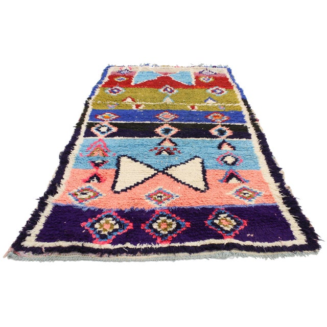 Vintage Berber Moroccan Boucherouite rug. A blend of pastel and stark hues of the colors woven into this piece work...