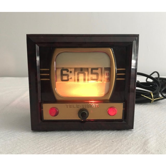 Neat vintage clock that looks like a television set. Made of bakelite. The knob in the front turns on the nite lite. Clock...