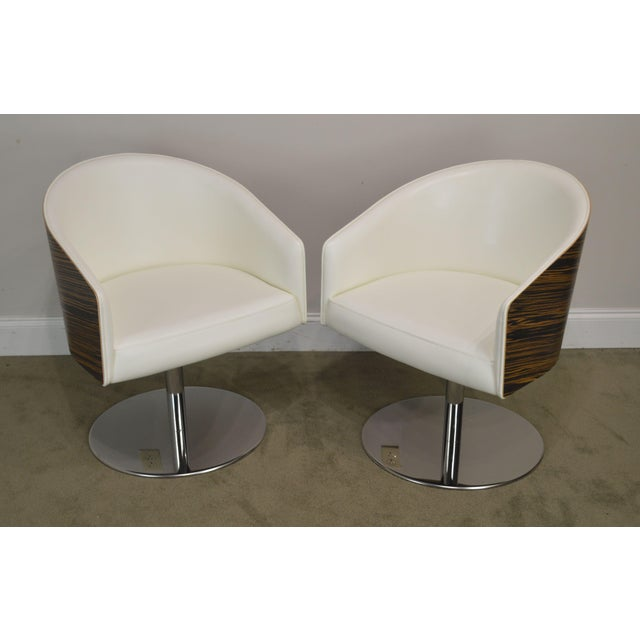 High Quality Pair of Zebra Wood & White Leather Swivel Lounge Chairs on Heavy Chrome Swivel Bases by Cape Furniture Inc....