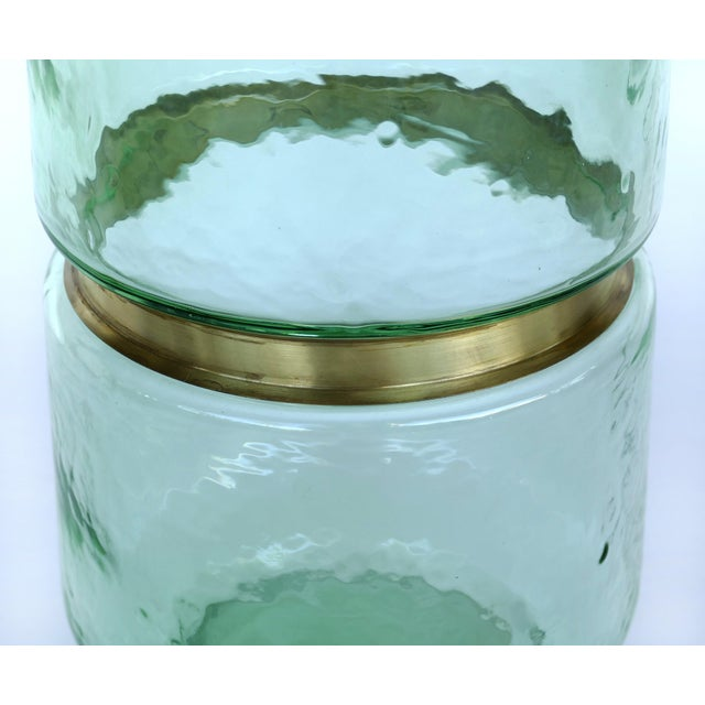 Offered for sale is a single vintage hand-blown green Lava glass vase with a decorative gilt metal band. There are 2...