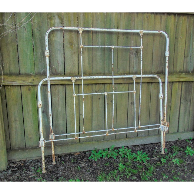 Gorgeous full size antique iron headboard and foot board set with chippy white paint and light surface rust coming...