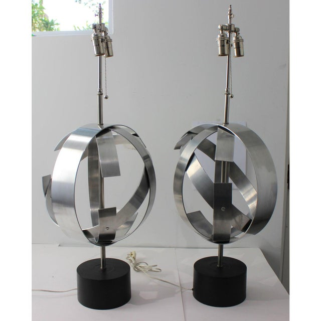 Stylish Armillary shaped table lamps in aluminum. Each one is styled slightly differently in this modernist abstract...