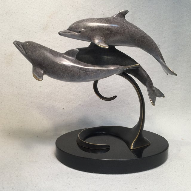 These darling Dolphin are having so much fun cruising the Ocean waves. They just seem to beamimg with joy. Just a lovely...